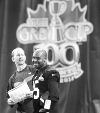 Stampeders quarterback Kevin Glenn (right) will take orders from  offensive co-ordinator Dave Dickenson during Sunday�s 100th Grey Cup game at Rogers Centre. Dickenson has been touted to become a head coach in the near future.