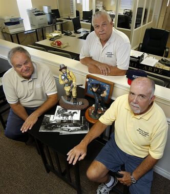 "Retire Detroit Police Dept. officers Al Grant, left, Don Taylor and Greg Trozak, right, of the Retired Detroit Police and Fire Fighters Association, pose for a photo with some police and firefighter memorabilia at their office Friday, July 19, 2013 in Sterling Heights, Mich. ""The retirement obligation and health care obligation of a workforce that used to support a 2 million population cannot be supported with the diminished population of 700,000,"" said Steve Miller, board chairman at insurance giant AIG who has turned around a number of struggling companies. Detroit's pensioners are likely to see benefit cuts. And because they're lower in the pecking order of creditors, they may bear the brunt of the city's ills. And many will have trouble taking the hit, especially those hurt in the line of duty. (AP Photo/Duane Burleson)"