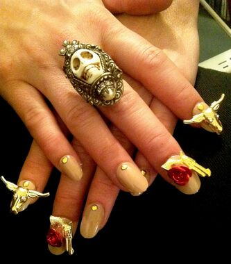 A western fingernail design by nail artist Naja Rickette.