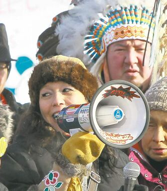 Grand Chief Derek Nepinak, joined by activist and former MP Tina Keeper (below), leads marchers to an Idle No More rally at the Oodena Celebration Circle at the The Forks.