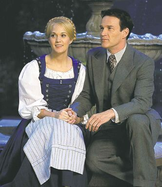 This image released by NBC shows Carrie Underwood, left, as Maria, and Stephen Moyer as Captain Von Trapp during preparations for
