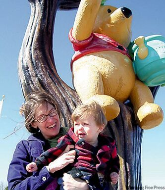 In White River, Ont., Katie Munnik poses with her son, Leo, and Winnie the Pooh.