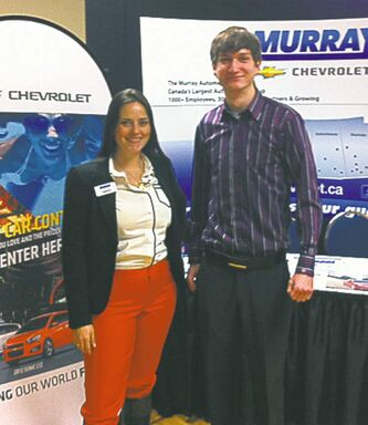 Amber Waller, Murray Chev's director of marketing, advertising and e-commerce, with sales rep Stefan Zhanel at the U of M careers fair.