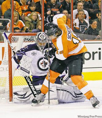 The Philadelphia Flyers' Brayden Schenn goes after the puck against Winnipeg Jets goalie Ondrej Pavelec during the first period at the Wells Fargo Center in Philadelphia, Pennsylvania, Tuesday.The Jets won 2-1 in a shootout.