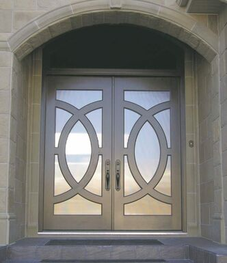 Circle door by Yarrow Sash and Door: stained cherry with glass inserts in circular frames.