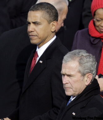 President Barack Obama and former President George W. Bush stand for the closing prayer on Jan. 20, after Obama was sworn in as the 44th president of the United States.