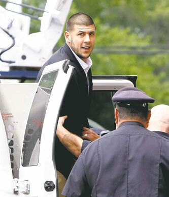 Former New England Patriots tight end Aaron Hernandez will remain in jail until another hearing Aug. 22.