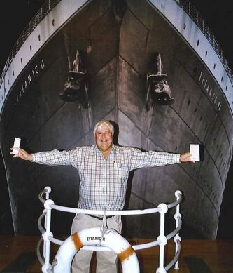 Clive Palmer in front of an artist's impression of the Titanic ll in Los Angeles.