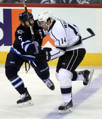 Winnipeg Jets Mark Stuart takes Los Angeles Kings Justin WIlliams out of the play in first period action at the MTS Center Thursday.