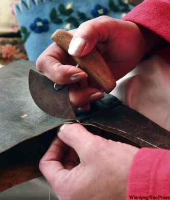 A a traditional ulu used to cut and scrape the skin.