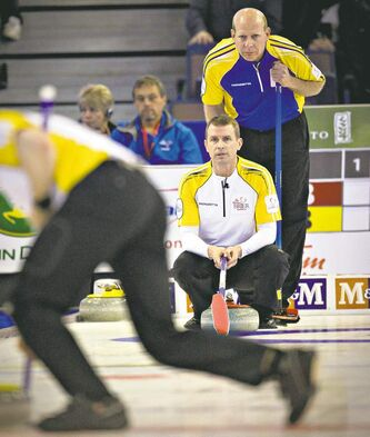 Alberta's Kevin Martin (rear) and Manitoba's Jeff Stoughton were locked in a heavyweight battle on the opening day of the Brier in Edmonton Saturday.