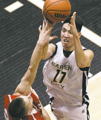 Garden City's Jowel Shuffler goes up for two against the MBCI Hawks on Monday night.