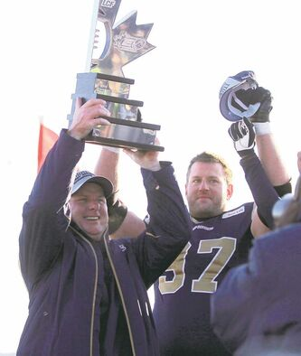 Happier times: Paul LaPolice holds up the East Division trophy as Doug Brown looks on last November.