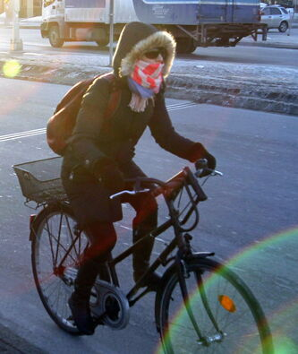 A cyclist braves the cold Friday morning.