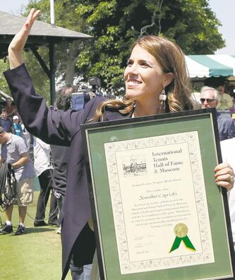 Tennis Hall of Fame inductee Jennifer Capriati accepts her plaque.