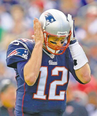 Pats QB Tom Brady reacts after throwing an end-zone interception against the Tampa Bay Buccaneers on Sunday.