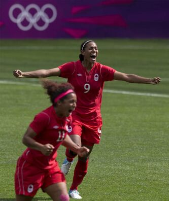 Canada defender Candace Chapman (9) and midfielder Desiree Scott (11) celebrate after winning the Bronze medal football game at the Olympic Games in Coventry, Great Britain, on Thursday.