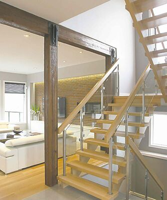 The tempered glass on the wide, angled staircase creates an open feel.