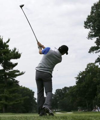 Rory McIlroy's swing always looks great, but lately, the ball hasn't been obeying his commands. Here he smokes one off the ninth tee during a Wednesday practice round at Oak Hill.