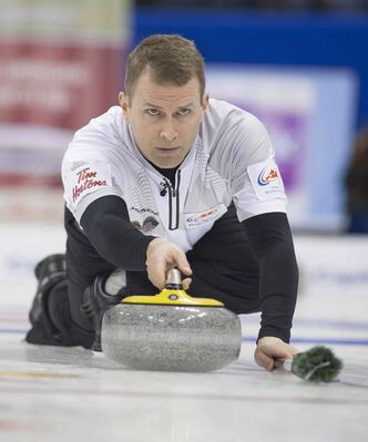 Jeff Stoughton delivers a rock during his opening game in the Roar of the Rings Olympic curling trials.
