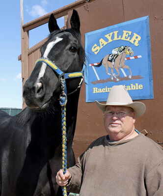 Trainer Ardell Sayler, shown here with 2013 J.W. Sifton Stakes winner Divine Wisdom, is off to a red-hot start at the Downs.