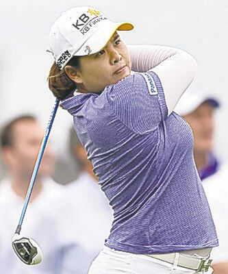Inbee Park, of South Korea, tees off the third hole during the final round at the U.S. Women's Open golf tournament at Sebonack Golf Club in Southampton, N.Y., Sunday, June 30, 2013. (AP Photo/Seth Wenig)