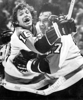 Flyer Reggie Leach (right) is hugged by Bobby Clarke after scoring an OT-winning goal in 1976.