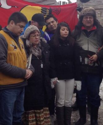 Manitoba Cross Lake Elder Raymond Robinson (far left) and Attiwapiskat Chief Theresa Spence (beside Robinson) both said Friday they will not end their hunger strike until they see what comes from the meeting Jan. 11.