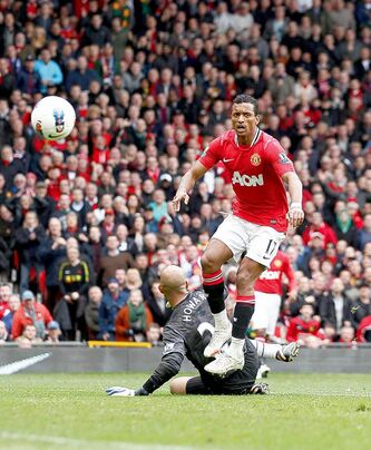 Manchester United's Nani puts one past Everton 'keeper Tim Howard during Premier League action.