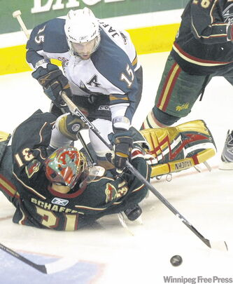 Manitoba Moose forward Jason Jaffray bowls over Houston Aeros goalie Nolan Schaefer during Game 2 Saturday.