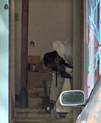 An RCMP forensics team member works inside Nielsen's house.