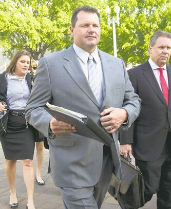 Former Major League Baseball pitcher Roger Clemens arrives at federal court in Washington in Washington, Monday, April 16, 2012, for jury selection in the perjury trial on charges that he lied when he told Congress he never used steroids and human growth hormone. (AP Photo/Manuel Balce Ceneta)