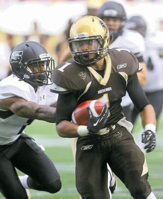 TREVOR HAGAN / WINNIPEG FREE PRESS Bison running back Anthony Coombs outpaces the Saskatchewan pursuit.