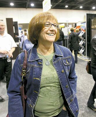 Deb Skrabek enjoys displays at the Home Expression Show at the convention centre Saturday.