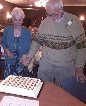 Rev. George Davidson and his wife Donna cut a cake baked for them at a farewell dinner held in their honour. He is retiring after 17 years leading Headingley United Church and St. Charles United Church.