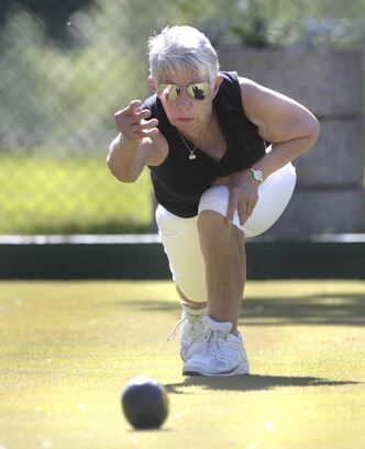 Sharon Lozinski warms up for a game at the St. John's Lawn Bowling Club on a beautiful Wednesday morning.