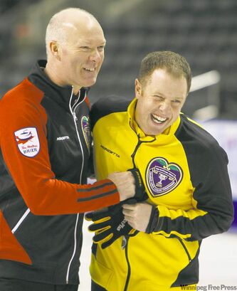 Ontario skip Glenn Howard and his nephew, New Brunswick second Steven Howard, joke around after practice Friday for the Tim Horton's Brier Canadian Curling Championship in London, Ont. Brier competition begins today and concludes with the final on March 13. Steven Howard is TSN  analyst Russ Howard's son.