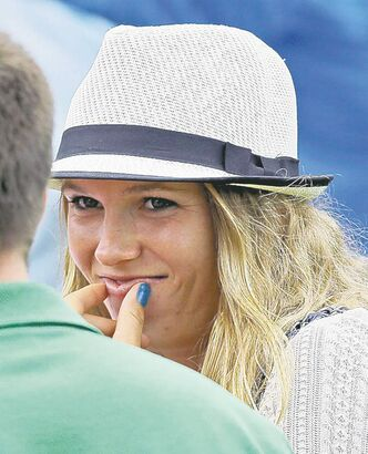 Tennis player Caroline Wozniacki is watching Rory McIlroy