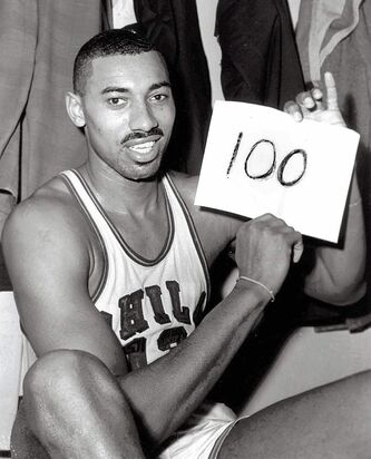 PAUL VATHIS / THE ASSOCIATED PRESS ARCHIVESPhiladelphia Warriors� Wilt Chamberlain displays his unequalled one-game point total in the dressing room in Hershey, Pa., after dropping 100 on the New York Knickerbockers in a 169-147 triumph March 2, 1962.
