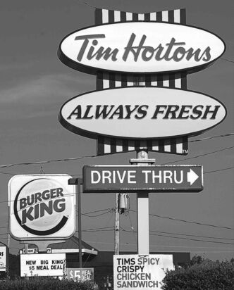 A Tim Hortons restaurant is seen located next to a Burger King restaurant in Lower Sackville, N.S. on Monday, August 25, 2014. Burger King is in talks to buy Tim Hortons in hopes of creating a new, publicly traded company with its headquarters in Canada. THE CANADIAN PRESS/Andrew Vaughan