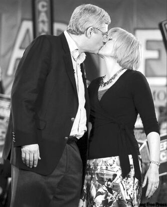 Stephen Harper and wife Laureen kiss following his speech to supporters during a campaign stop in Windsor, N.S., Saturday.