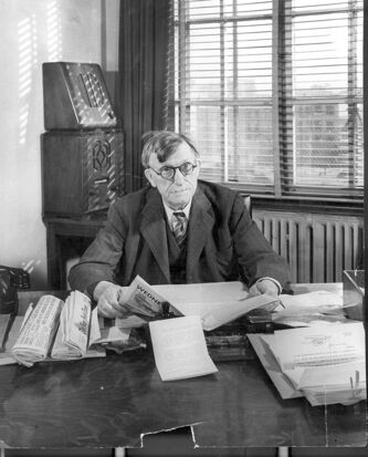 Free Press editor John W. Dafoe at his desk.