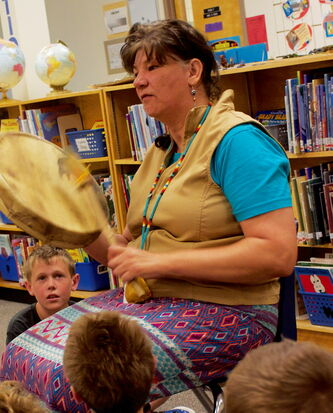 River East Transcona School Division Aboriginal community networker Lisa Aymont Hunter hits a drum during a presentation to Dr. F.W.L. Hamilton School students as part of a multicultural event on May 30.