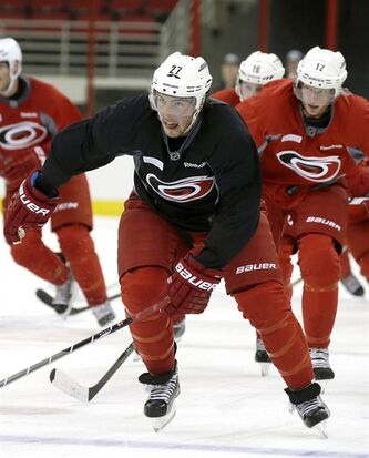 In this photo taken Thursday, Sept. 12, 2013, Carolina Hurricanes' Justin Faulk (27) skates during the first day of NHL hockey training camp in Raleigh, N.C. The NHL's realignment meant the end of the Southeast Division and placed the Hurricanes into the new Metropolitan Division. (AP Photo/Gerry Broome)
