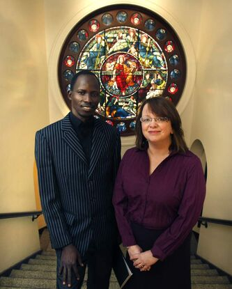 Rev. Stephen Mayuen Mou, a former soldier, with theology professor Jane Barter Moulaison.