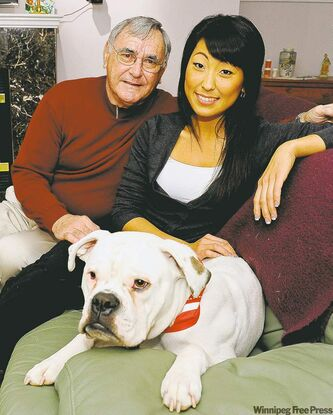 Kim Parker, with adoptive father Ron Parker and her dog Shrek, said she has no desire to go to Korea.