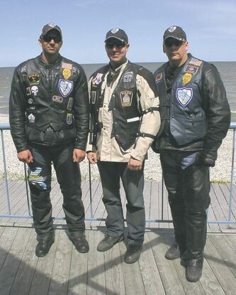 Motorcycles have always been popular with law enforcement officers and a small group from the Blue Knights Motorcycle Club made the trip to Manitoba. Grand Forks Police Department Patrolman Rory Suby (left) and Sgt. Mark Ellingson (right) were joined by fellow Blue Knights member and Winnipeg Police Service Const. Blair Savinkoff.