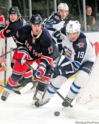 New York Rangers' Brandon Dubinsky (17) chases Winnipeg Jets' Jim Slater (19) during the first period of an NHL hockey game, Sunday, Nov. 6, 2011, in New York. (AP Photo/Frank Franklin II)