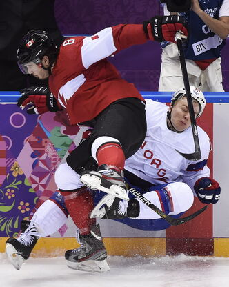 Canada defenceman Drew Doughty levels Norwegian forward Per-Age Skroder in the second period Thursday. Head coach Mike Babcock welcomed the win, but more so the chance to see the players in action.