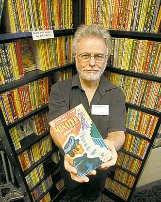 Winnipeg bookseller Burton Lysecki with the first 500 Harlequin books in 2009.